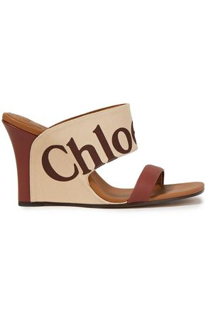 CHLOÉ Leather-paneled logo-print cotton-blend canvas wedge mules