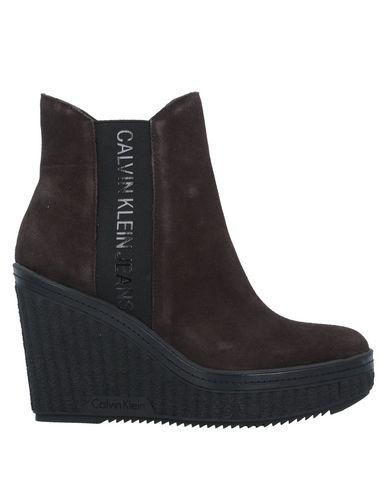 Полусапоги и высокие ботинки Calvin Klein Jeans