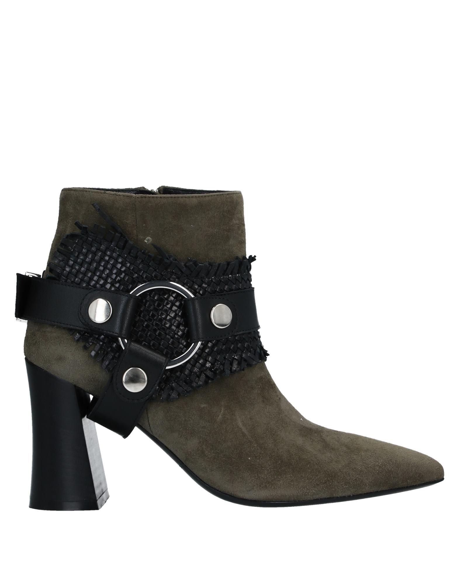 STEPHANE KÉLIAN Полусапоги и высокие ботинки