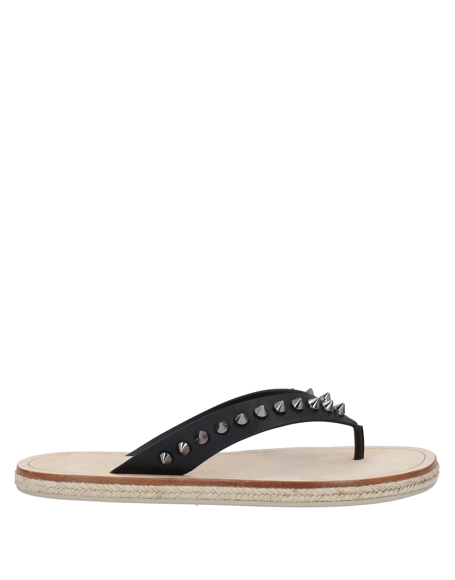 CHRISTIAN LOUBOUTIN Toe strap sandals. leather, studs, solid color, round toeline, flat, unlined, rubber cleated sole, contains non-textile parts of animal origin. 100% Calfskin