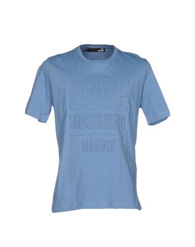 Фото - Женскую футболку  пастельно-синего цвета