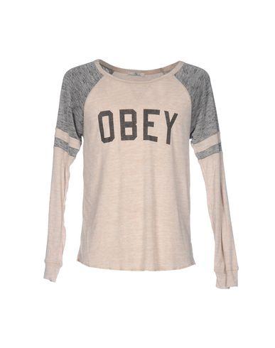 Фото - Женскую футболку OBEY бежевого цвета