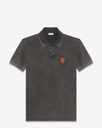 SAINT LAURENT Polos U YSL Shield Patch Polo Shirt in Washed Black Piqué Cotton f