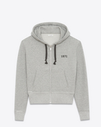 SAINT LAURENT Sportswear Tops U Zippered hoodie in a flecked gray knit with a 1971 print f