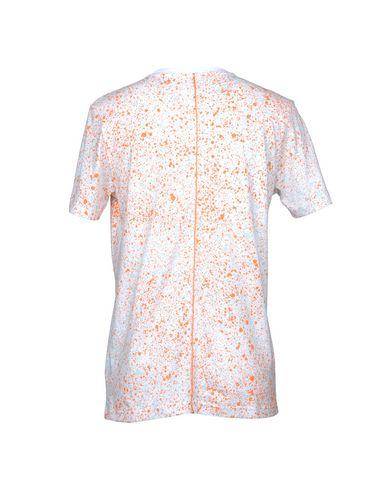 Фото 2 - Женскую футболку PUMA X DAILY PAPER белого цвета