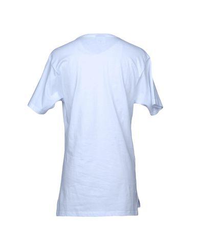 Фото 2 - Женскую футболку FOLLOW US белого цвета