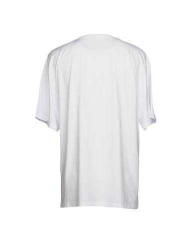 Фото 2 - Женскую футболку U.T. WAVE белого цвета