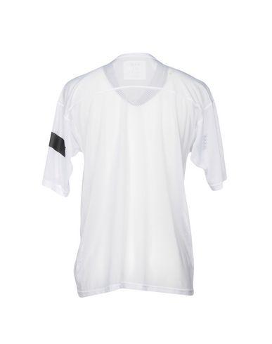 Фото 2 - Женскую футболку SOLD OUT белого цвета