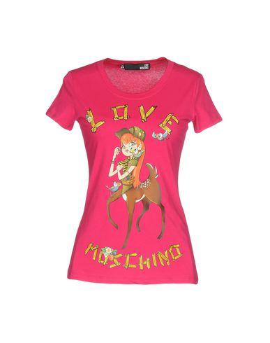 Фото - Женскую футболку  цвета фуксия