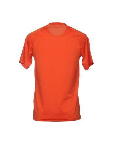 Фото 2 - Женскую футболку PEAK PERFORMANCE оранжевого цвета