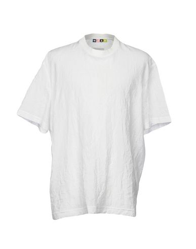 Фото - Женскую футболку MSGM белого цвета