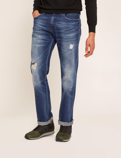 STRAIGHT-FIT MID-INDIGO JEAN WITH DISTRESSING