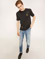 ARMANI EXCHANGE SKINNY-FIT WASHED LIGHT INDIGO JEAN Skinny jeans Man a