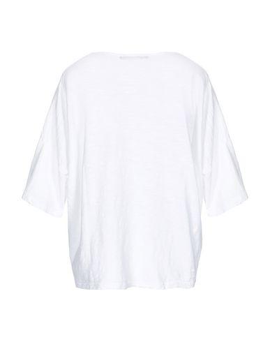Фото 2 - Женскую футболку NEVER ENOUGH белого цвета