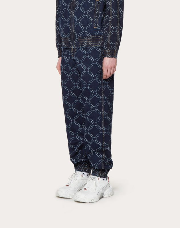 JOGGING BOTTOMS IN DENIM JACQUARD WITH VLTN GRID