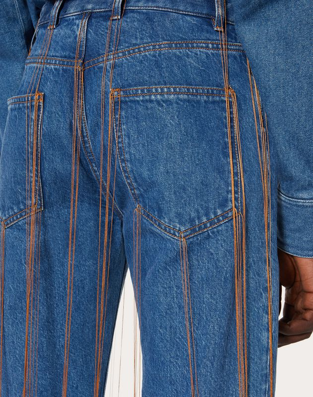 DENIM JEANS WITH TOBACCO FRINGING