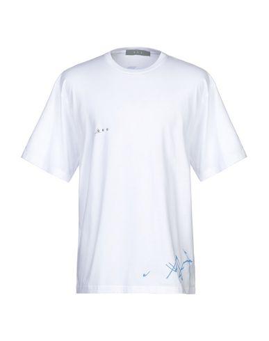 Фото - Женскую футболку GEO белого цвета