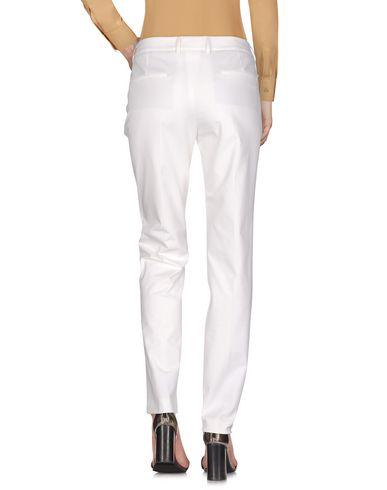 Фото 2 - Повседневные брюки от INCOTEX белого цвета