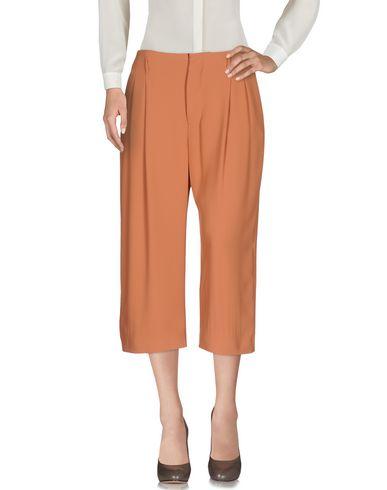 Фото - Укороченные брюки цвет телесный