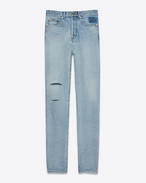 SAINT LAURENT Slim fit U Jean slim à trous en denim bleu clair 70's f