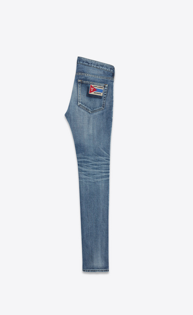 SAINT LAURENT Skinny fit U Jean skinny à taille basse et écusson SAINT LAURENT UNIVERSITÉ en denim bleu moyen b_V4