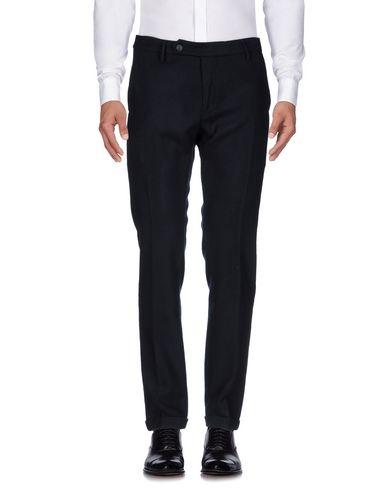 Фото - Повседневные брюки от OPIFICI CASENTINESI® темно-синего цвета