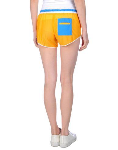 Фото 2 - Повседневные шорты от BOBBY KOLADE оранжевого цвета