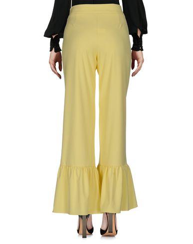 Фото 2 - Повседневные брюки от HUITDEGRÉS желтого цвета