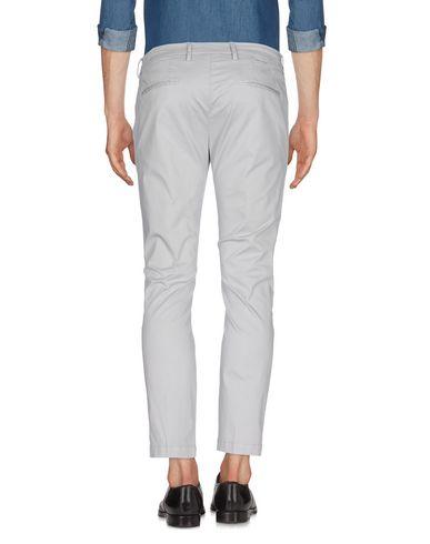 Фото 2 - Повседневные брюки от MICHAEL COAL серого цвета