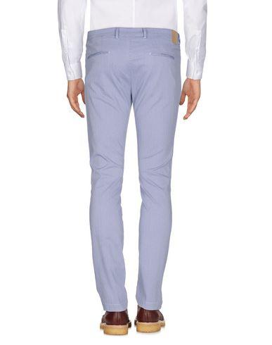 Фото 2 - Повседневные брюки от MICHAEL COAL синего цвета