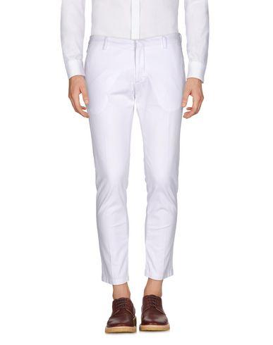 Фото - Повседневные брюки от MICHAEL COAL белого цвета