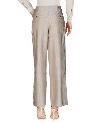 Фото 2 - Повседневные брюки от FORTE_FORTE бежевого цвета