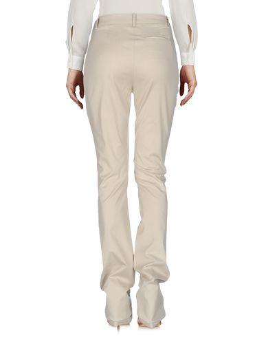 Фото 2 - Повседневные брюки от ERMANNO DI ERMANNO SCERVINO бежевого цвета