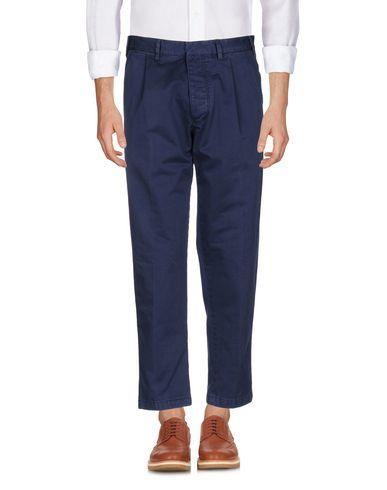 Фото - Повседневные брюки от THE GIGI темно-синего цвета