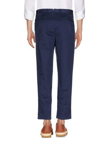 Фото 2 - Повседневные брюки от THE GIGI темно-синего цвета