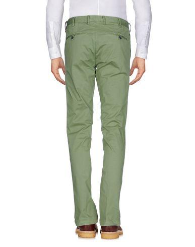 Фото 2 - Повседневные брюки от AT.P.CO светло-зеленого цвета