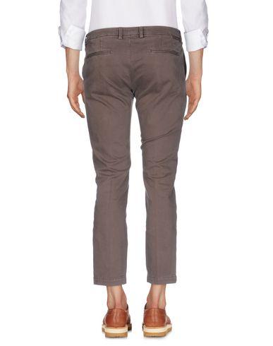 Фото 2 - Повседневные брюки от MICHAEL COAL цвета хаки