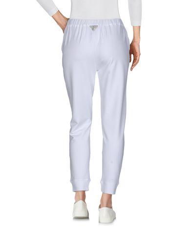 Фото 2 - Повседневные брюки от VDP CLUB белого цвета