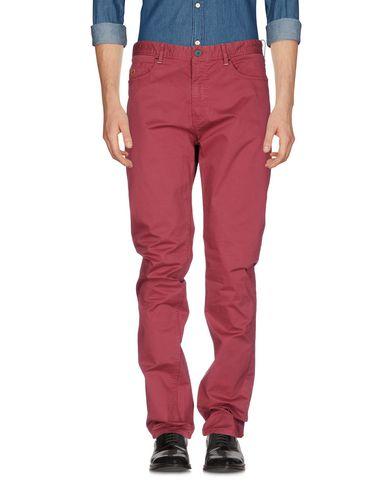 Фото - Повседневные брюки от AT.P.CO кирпично-красного цвета