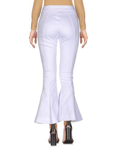 Фото 2 - Повседневные брюки от NINEMINUTES белого цвета