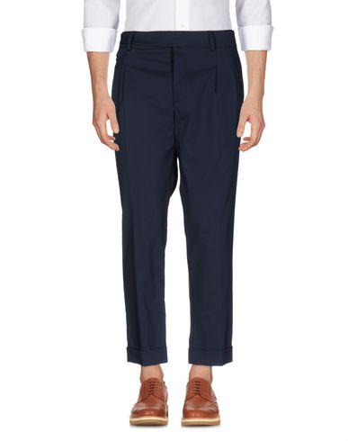 Фото - Повседневные брюки от DELÀNGE темно-синего цвета