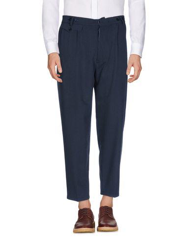 Фото - Повседневные брюки от JOHN SHEEP темно-синего цвета