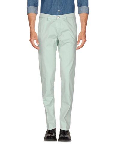 Фото - Повседневные брюки от FRADI светло-зеленого цвета