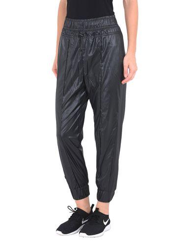 Imagen principal de producto de NIKE PANT SWOOSH - PANTALONES - Pantalones - Nike