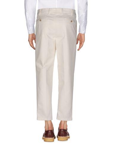 Фото 2 - Повседневные брюки от THE GIGI цвет слоновая кость