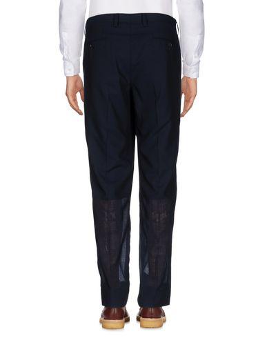 Фото 2 - Повседневные брюки от ISSEY MIYAKE MEN темно-синего цвета