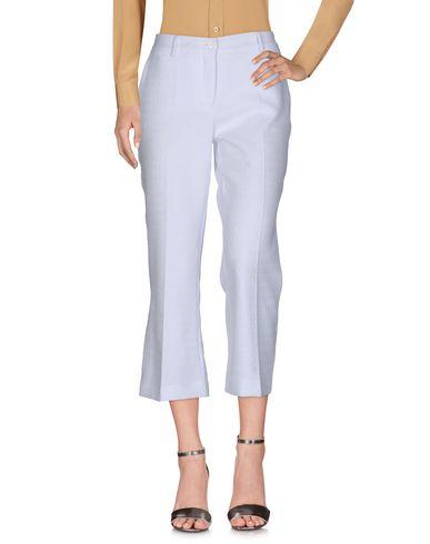 Фото - Повседневные брюки от P.A.R.O.S.H. белого цвета