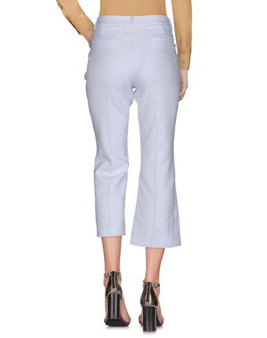 Фото 2 - Повседневные брюки от P.A.R.O.S.H. белого цвета
