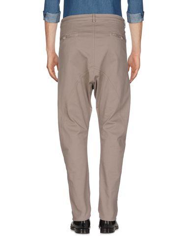 Фото 2 - Повседневные брюки от POÈME BOHÈMIEN серого цвета