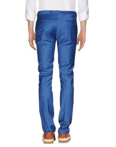 Фото 2 - Повседневные брюки от BRIAN DALES синего цвета